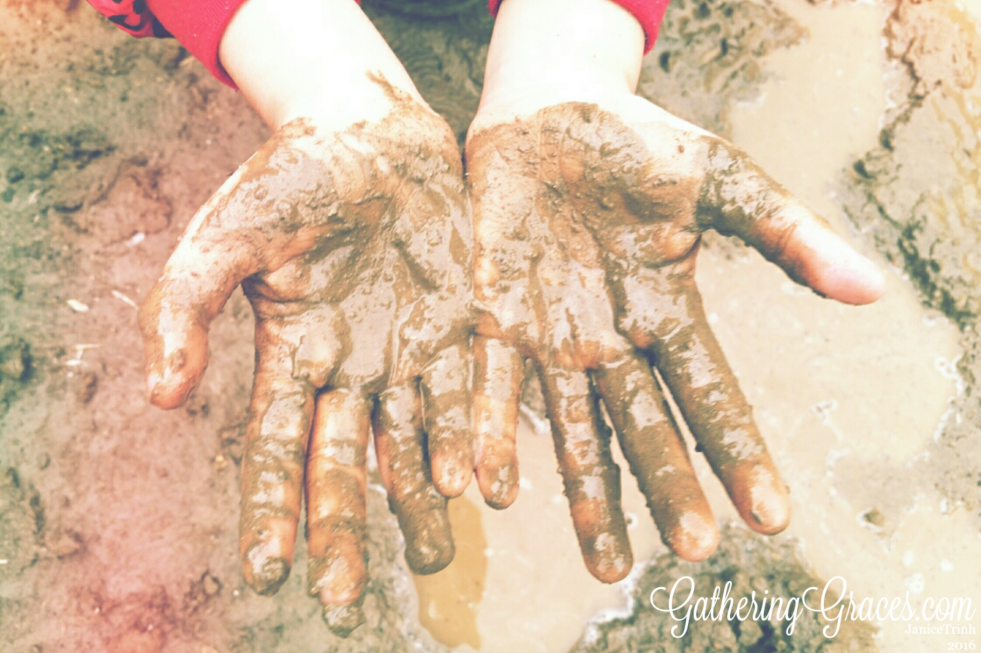 kid muddy hands